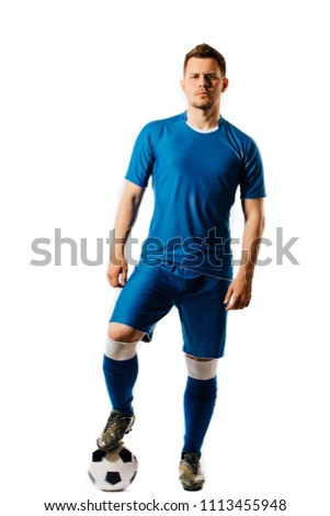 Young handsome football player with a soccer ball posing isolated on white background. in full growth.