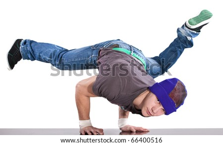 Young handsome fresh man breakdancing with stylish clothes.