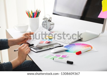 Young Handsome Graphic designer using graphics tablet to do his work at desk #1308609367
