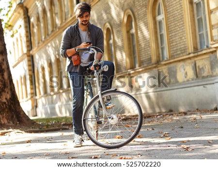 young handsome guy on a bicycle ...