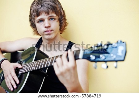 young handsome guy with a guitar.