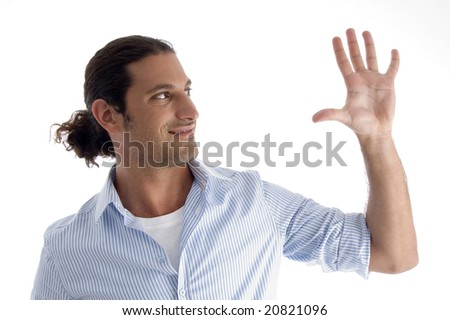 young handsome guy with open palm on an isolated white background