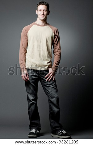Young handsome happy man wearing casual cloths.
