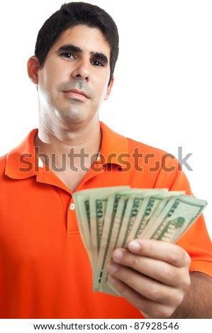 Young handsome hispanic man giving out american money isolated on white