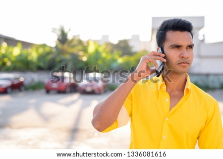 8dfc818650 Portrait of a South Indian man talking on a mobile phone Free Images ...