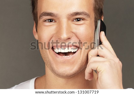 Young handsome man calls by mobile telephone.
