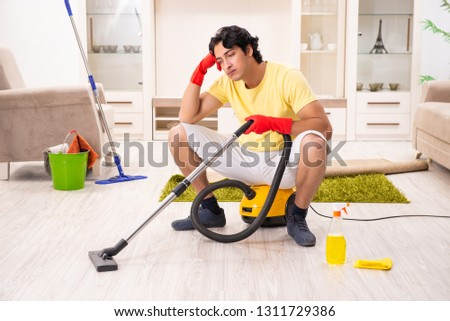Young handsome man doing housework #1311729386