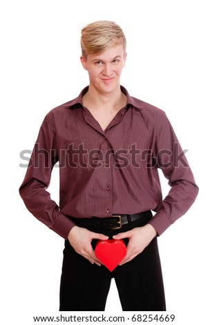 Young  handsome man holding a heart shaped gift box