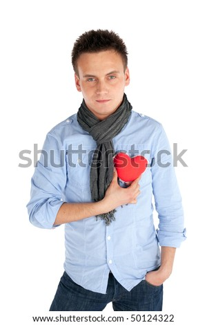 Young handsome man holding heart in his hand, giving it to somebody. Isolated over white background.