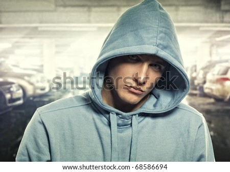 stock photo : Young handsome man in a hood