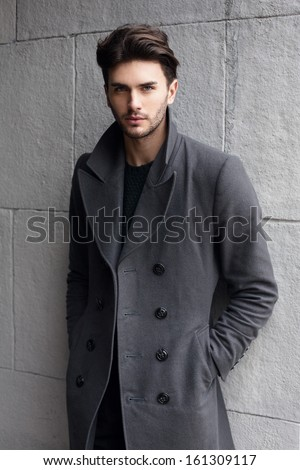 Young handsome man in coat