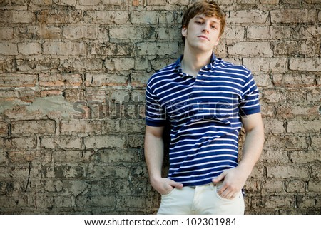 Young handsome man in polo shirt relaxing.