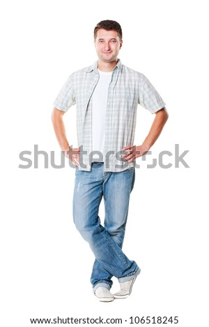 young handsome man in shirt and jeans posing over white background