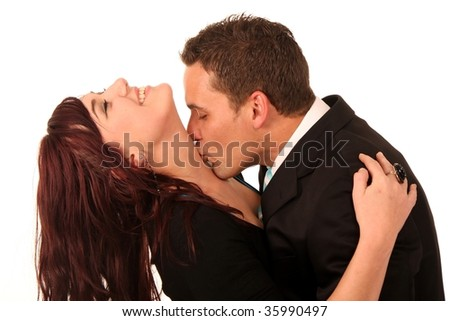 Young handsome man kissing his beautiful girlfriend on her neck
