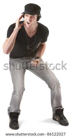 Young handsome man listens to music on headphones over white background