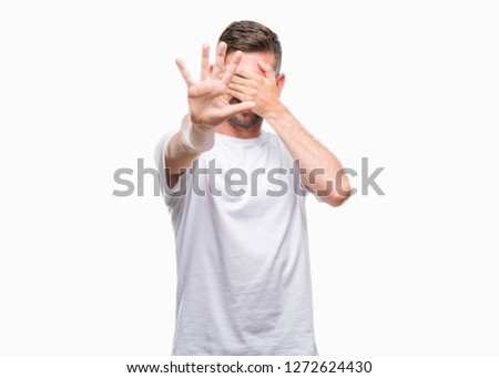 Young handsome man over isolated background covering eyes with hands and doing stop gesture with sad and fear expression. Embarrassed and negative concept. #1272624430