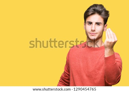Young handsome man over isolated background Doing Italian gesture with hand and fingers confident expression #1290454765