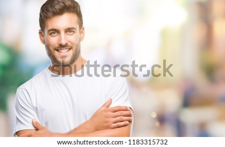 Young handsome man over isolated background happy face smiling with crossed arms looking at the camera. Positive person. #1183315732
