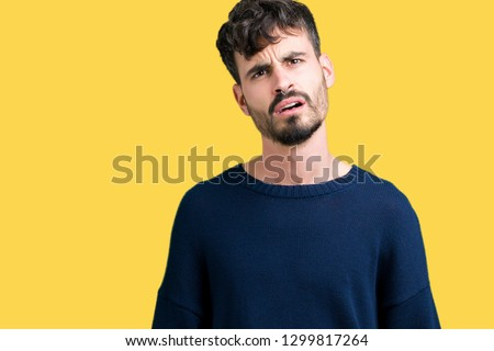 Young handsome man over isolated background In shock face, looking skeptical and sarcastic, surprised with open mouth