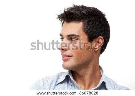 Young handsome man portrait isolated on white while looking at his left