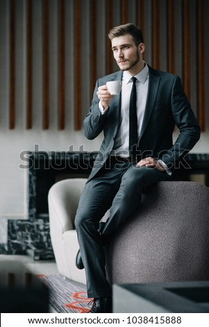 Fashion Men Model Poses For Fashion Photography Indoor