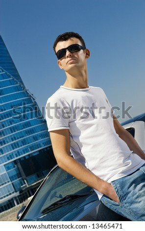 Young handsome man relaxing outdoors