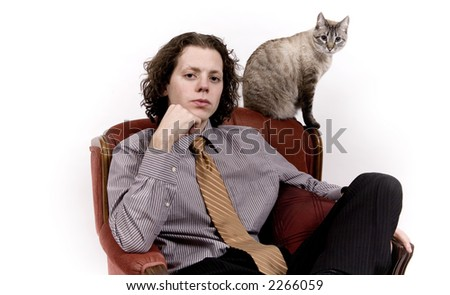 Young handsome man sits with his cat