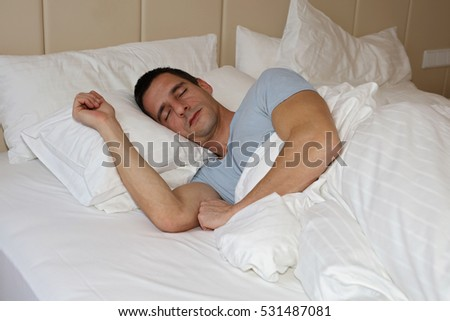 Young handsome man sleeping comfortably in bed #531487081