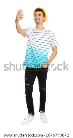 Young handsome man taking selfie against white background