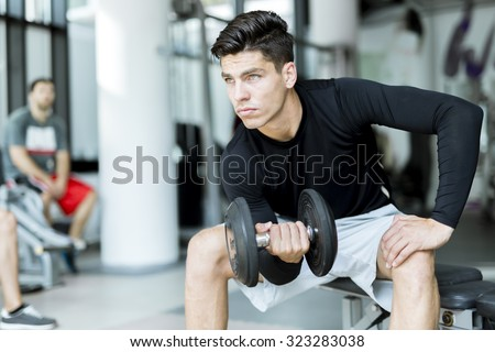 Young handsome man training in a fitness center