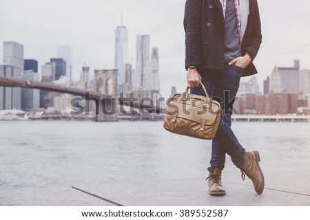 Young handsome man wearing a fashionable outfit in the city