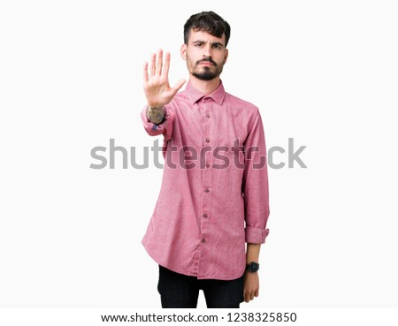 b6011dfa Young handsome man wearing pink shirt over isolated background doing stop  sing with palm of the