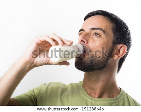 Young Handsome Man with Beard drinking Milk and Yogurt isolated on White Background