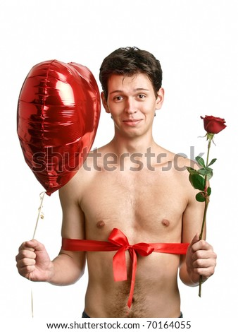 young handsome man with big heart and red rose like a present