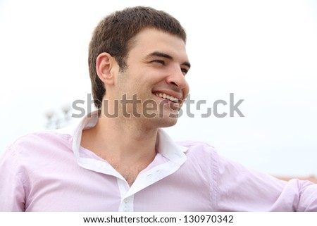 Young handsome man with great smile, outdoors portrait