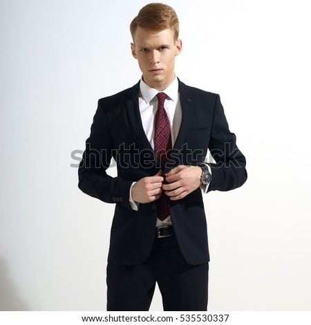 2fdf2f559a49 Young handsome man with red hair in black classical formal suit, white  jacket and red