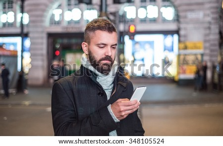 Young handsome man with smart phone in London city #348105524