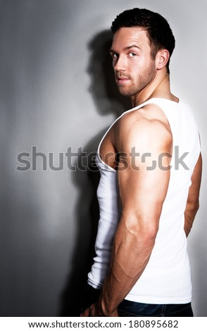 Young handsome muscular man in white t-shirt