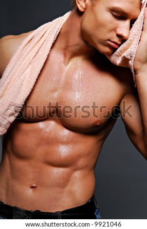 Young handsome muscular man with beautiful muscular body. Isolated on white.