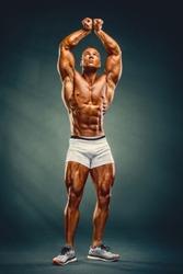 Young Handsome Muscular Men Flexing Muscles
