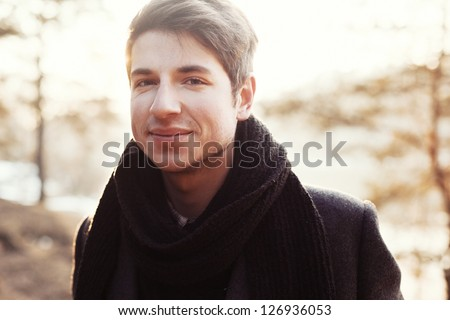 Young handsome smiling man outdoor portrait