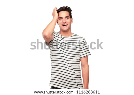 Young handsome tanned man happily realizing some good and surprising news or having a great idea, smiling with an amazed expression while touching head with hand. #1116288611