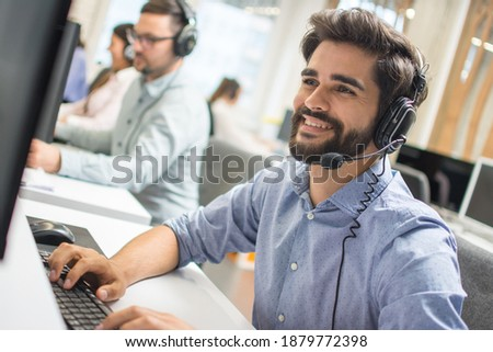 Young handsome technical support dispatcher working in call center. Photo stock ©