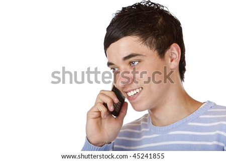 Young handsome teeanger makes a mobile phone call. Isolated on white.