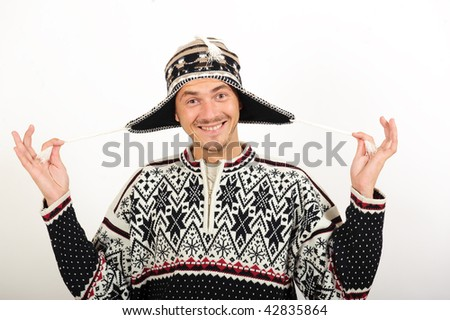Young handsome winter man in knit clothes