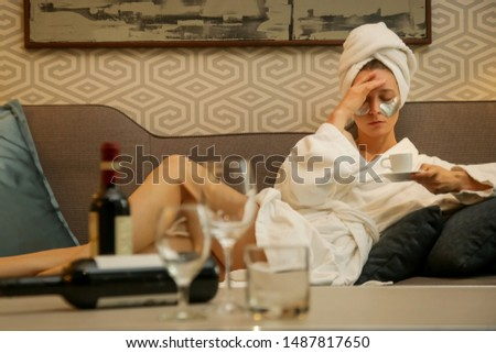 Young hangover woman drinking coffee trying to get ready for the day ahead, Monday morning concept, the morning after drinking alcohol	 Stock photo ©