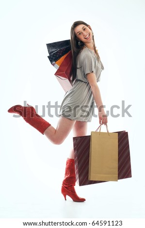 Young happiness woman holding several shopping bags