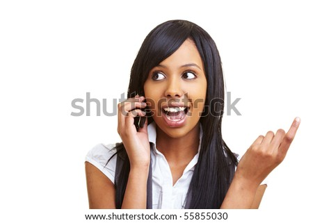Young happy african woman talking into her cell phone