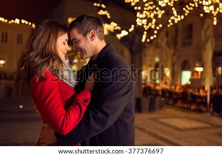 Shutterstock Young happy attractive amorous couple embracing  and kissing outdoor