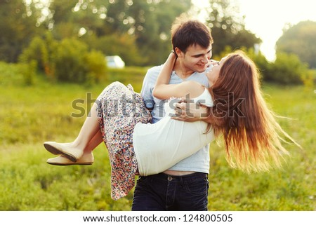 Young happy attractive couple walking together, outdoors